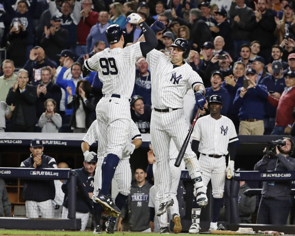 The Yankees' Aaron Judge celebrates with Gary Sanchez after hitting a two-run home run in the fourth inning Tuesday night in New York.