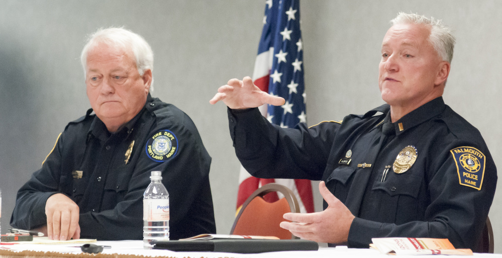 The Portland Fire Department's Deputy Chief Terry Walsh, left, and Falmouth police Lt. John Kilbride were on a panel for the Maine Municipal Association convention discussion on opioids Wednesday at Augusta Civic Center.