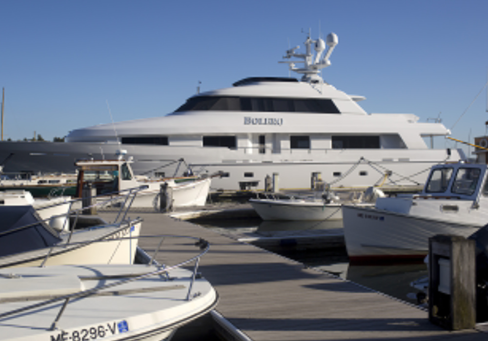 Bolero, a large yacht docked in South Freeport, is late returning to Florida because of Hurricane Irma, and marina damage there may force the owner to keep other boats in Maine this winter.