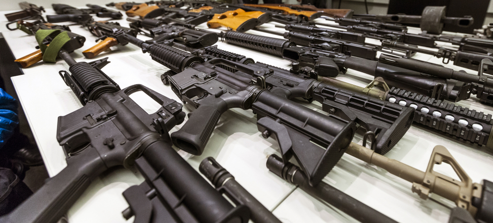 A variety of military-style semi-automatic rifles obtained during a buy back program are displayed at Los Angeles police headquarters. While recent American mass killers might not seem to follow any pattern, their access to high-powered weaponry remains a constant.