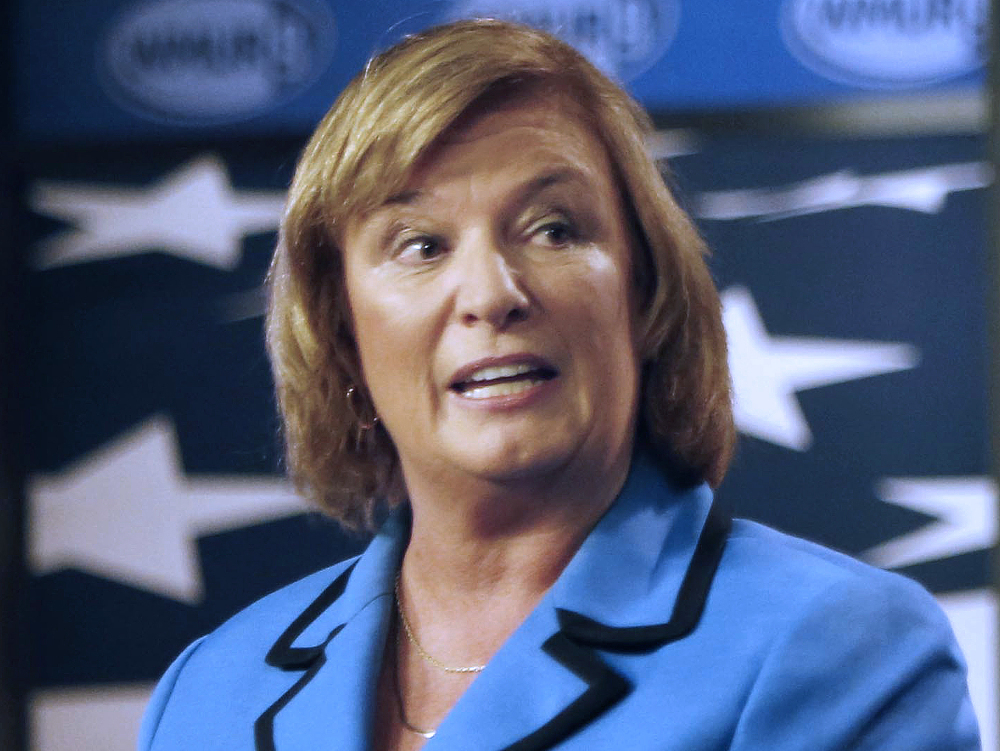 FILE - In this Oct. 27, 2014 file photo, U.S. Rep. Carol Shea-Porter D-N.H., speaks during a debate with her opponent, former Republican U.S. Rep. Frank Guinta, in Manchester, N.H. Shea-Porter, the first woman from New Hampshire elected to Congress, said Friday, Oct. 6, 2017, she's retiring at the end of her term. (AP Photo/Jim Cole, File)