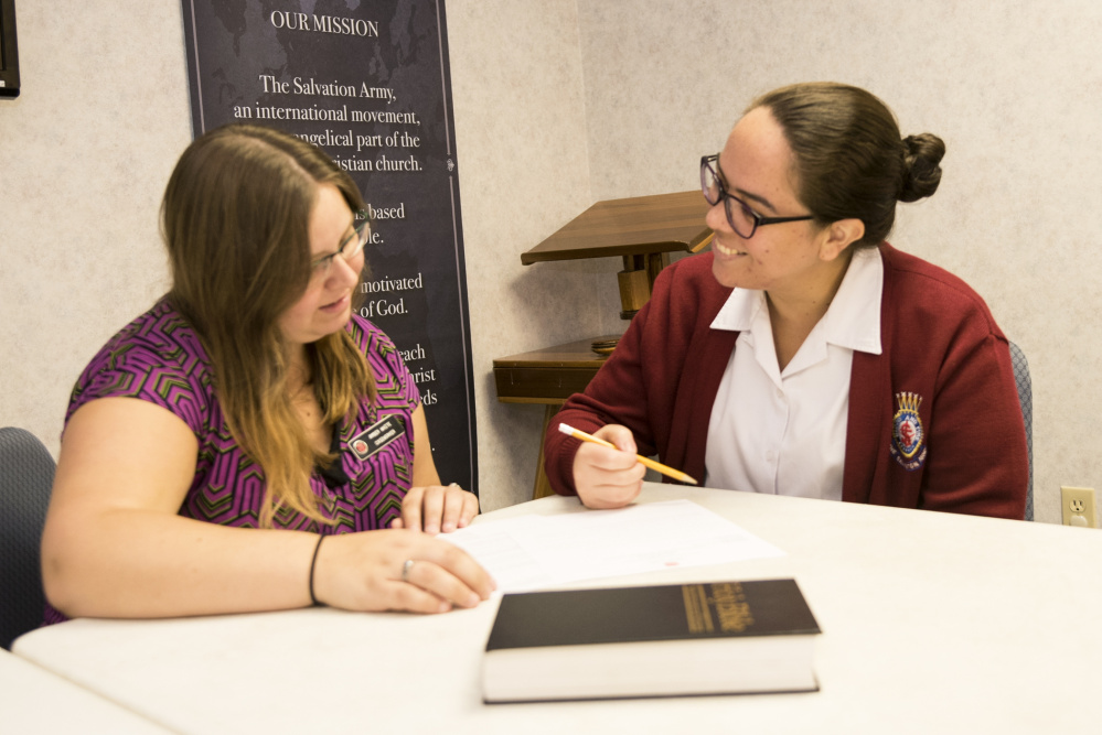 Salvation Army caseworker Amber White, left, meets with Lt. Anagelys Cruz on Friday. The two discussed arrangements for Cruz's upcoming trip to Puerto Rico. Cruz, who was born in Puerto Rico, plans to provide assistance to residents affected by the devastating hurricane.