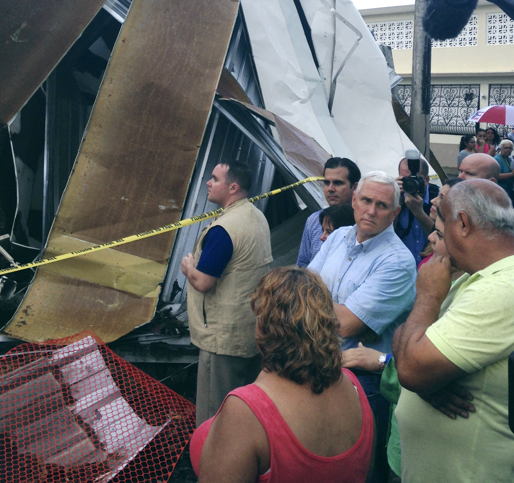 Vice President Mike Pence visits San Juan, Puerto Rico, on Friday. Hurricane Maria wiped out power and left the island's 3.4 million people short of food and supplies.