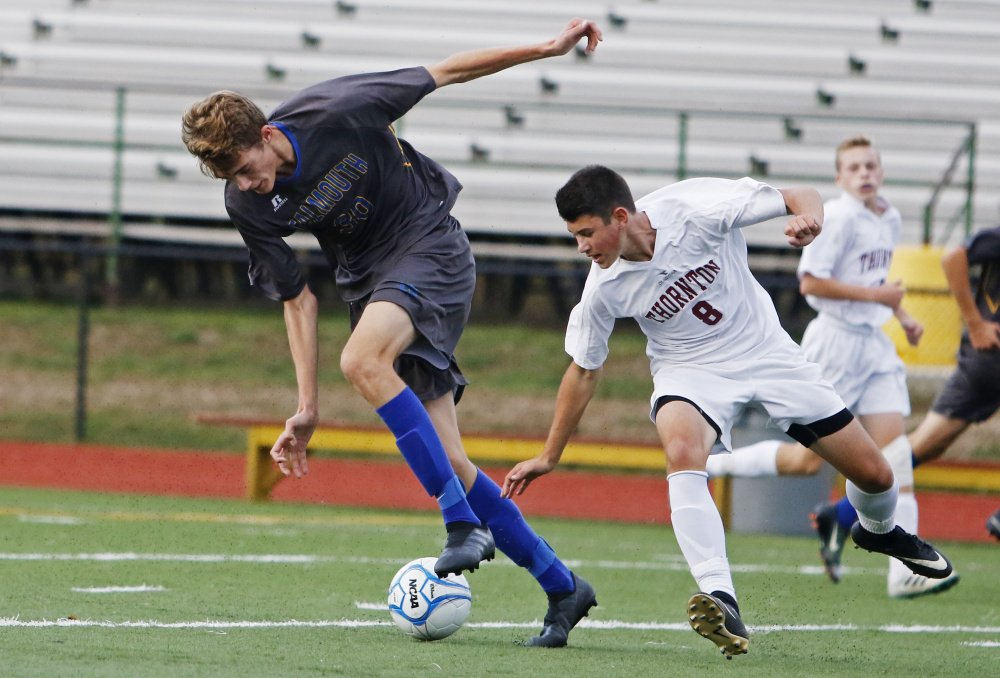 Nick Hester of Falmouth attempts to settle the ball as Eric McCallum of Thornton Academy looks to take it away Friday during the first half of Falmouth's 5-3 victory in an SMAA game at Saco.