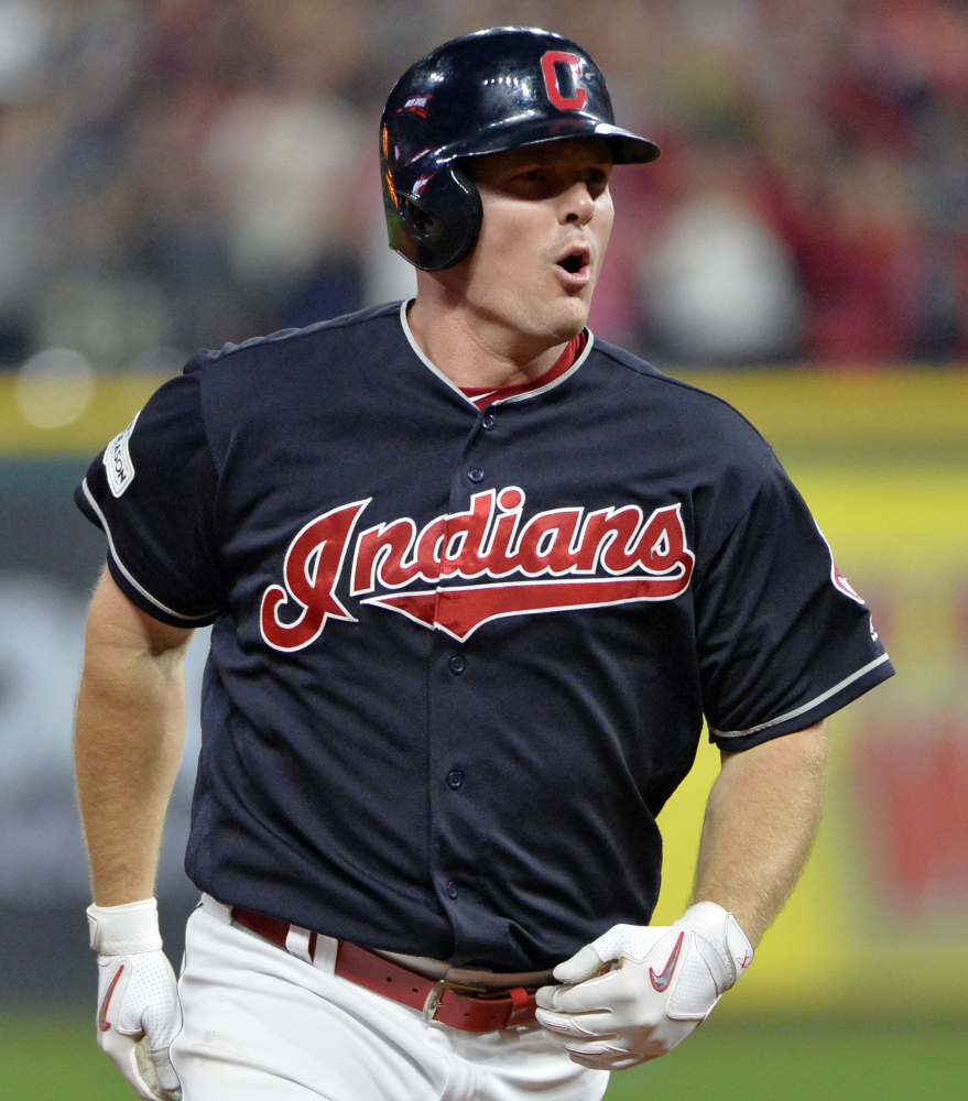 Jay Bruce of the Indians rounds the bases after hitting a solo home run off Yankees reliever David Robertson that tied Game 2 of their ALDS, 8-8, in the eighth inning Friday night.