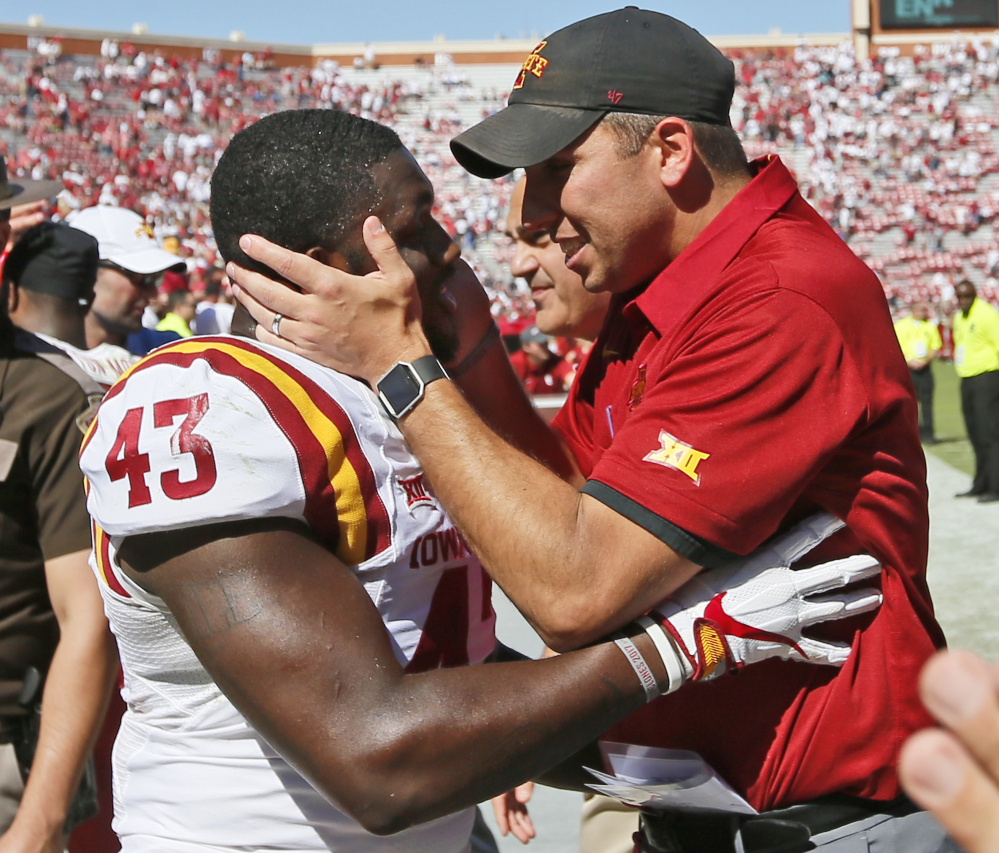 Iowa State Coach Matt Campbell celebrates with linebacker Tymar Sutton after the Cyclones upset No. 3 Oklahoma 38-31 on Saturday in Norman, Okla. The loss snapped Oklahoma's 14-game winning streak.