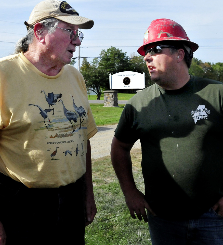Phil Frizzell, left, of the nonprofit Palermo Community Center, and Chad Grignon of Pine State Drilling, which drilled a new water well for the center.