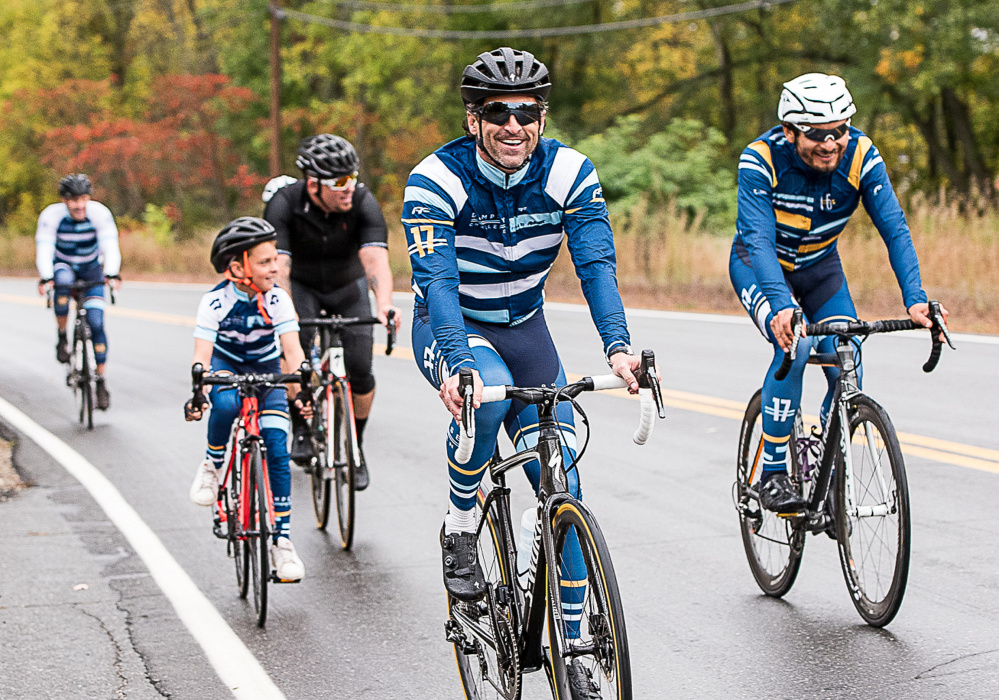 Patrick Dempsey rides down Riverside Drive in Auburn on the first leg of his Dempsey Challenge bike ride Sunday.