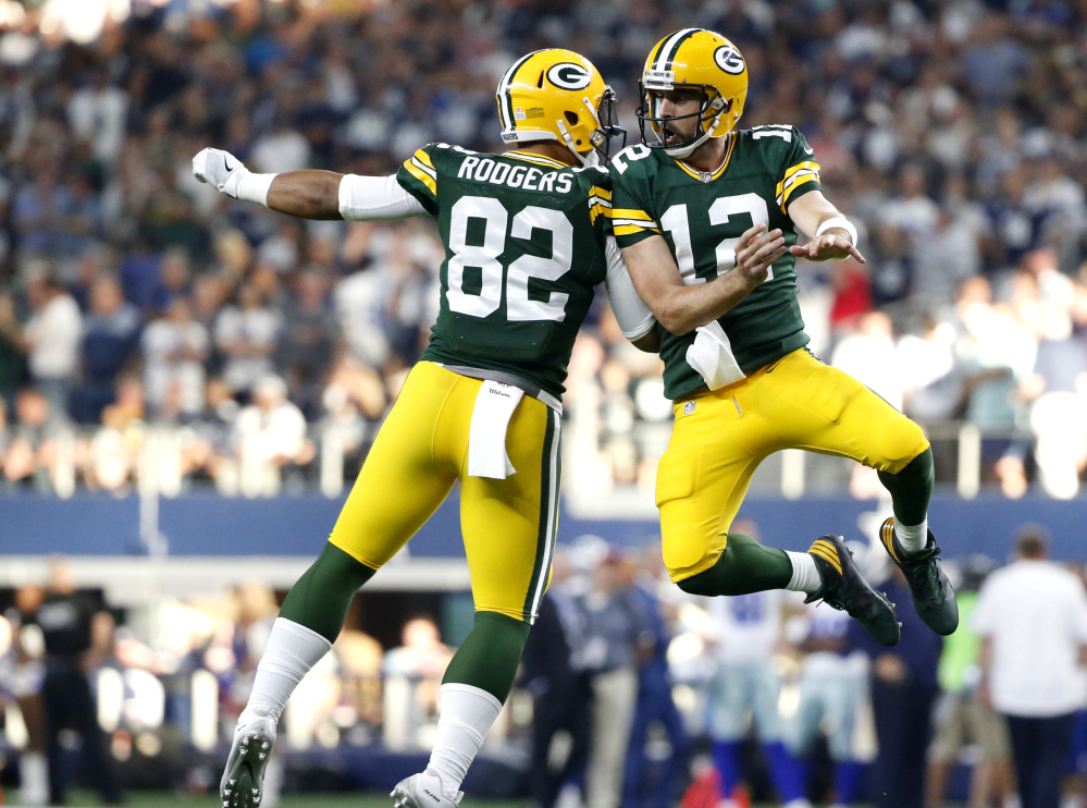 Packers tight end Richard Rodgers and quarterback Aaron Rodgers celebrate a late TD catch by Davante Adams that propelled Green Bay to a 35-31 win over the Cowboys.
