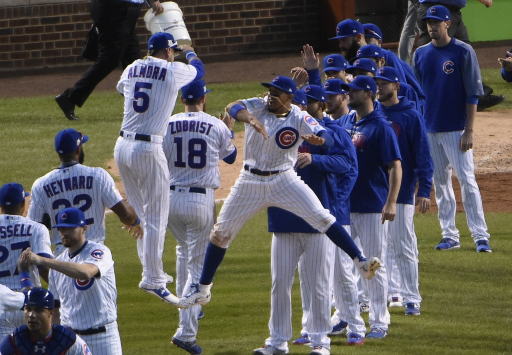 The Cubs' Albert Almora Jr. and Javier Baez celebrate their win in Game 3 of the National League Division Series on Monday in Chicago. The Cubs won 2-1 to take a 2-1 lead in the series.