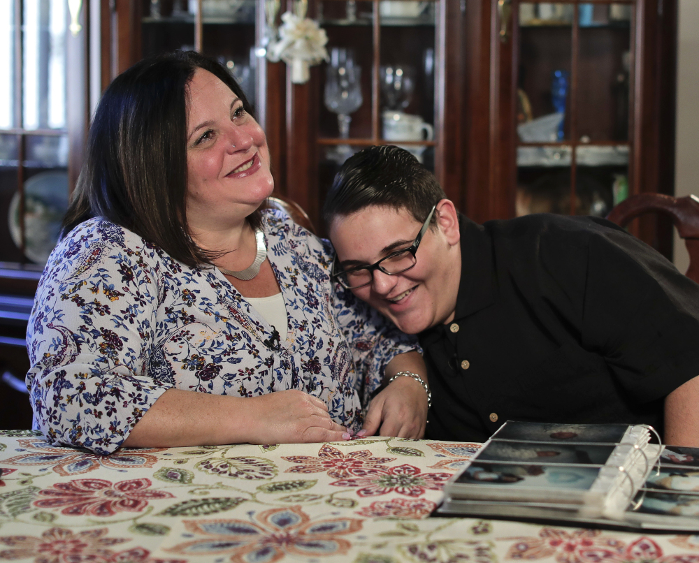 Beth Guardino and her son, Christian, 17, talk about his life before and after gene therapy treatment for his hereditary blindness during an Oct. 2 interview in Patchogue, N.Y.
