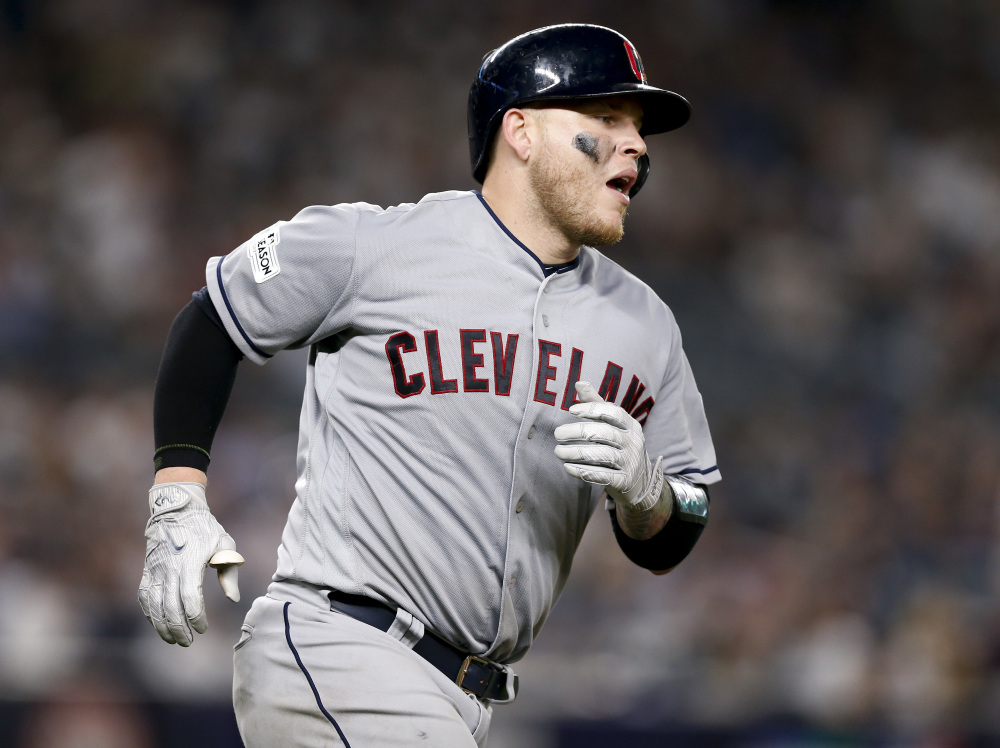 The Indians' Roberto Perez rounds the bases after hitting a solo home run in the fifth inning and cutting New York's lead to 5-3.