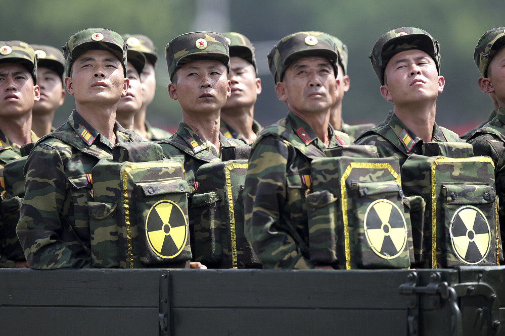 "North Korean soldiers carrying packs marked with the nuclear symbol during a military parade in Pyongyang. An Army spokesman, aware of reports of a breach, said, ""we are confident in the security of our operations plans."""