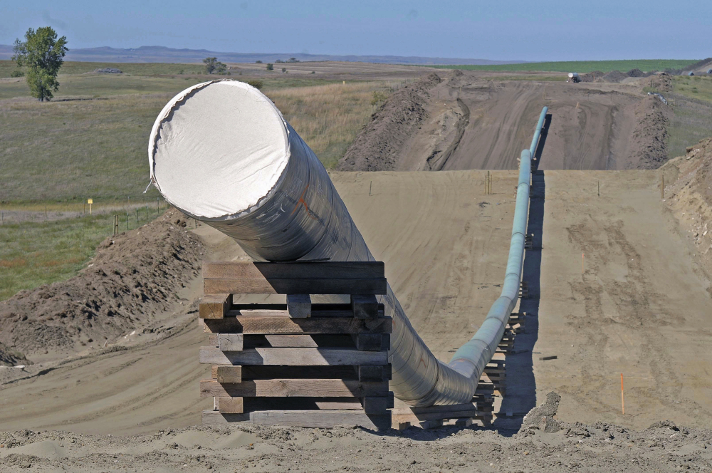 A federal judge ruled Wednesday that the Dakota Access oil pipeline, shown during construction in North Dakota last year, can continue operating while a study is completed to assess its environmental impact on the Standing Rock Sioux.