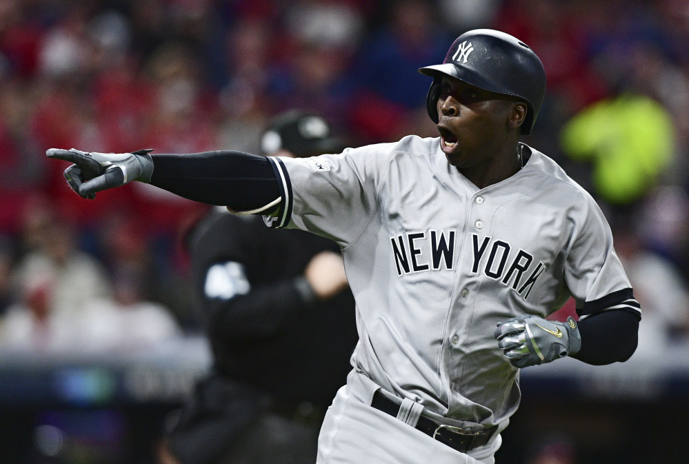 Didi Gregorius points to the dugout after hitting a two-run home run off Corey Kluber in the third inning of Game 5 of a baseball American League division series Wednesday night in Cleveland.