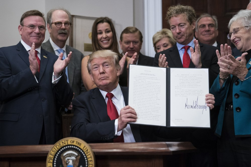 President Trump signs his executive order on health care Thursday at the White House. Later in the day, the administration confirmed that Trump will end payments to health insurers that help millions of lower-income Americans afford coverage.