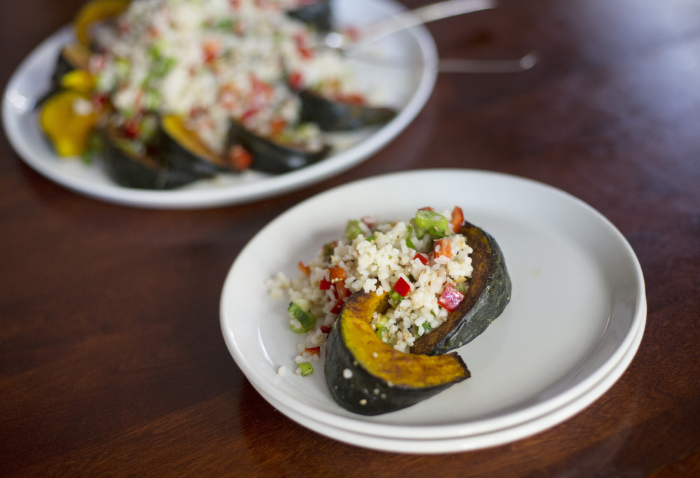 Cold-Climate Rice Salad is served on a bed of roasted squash.