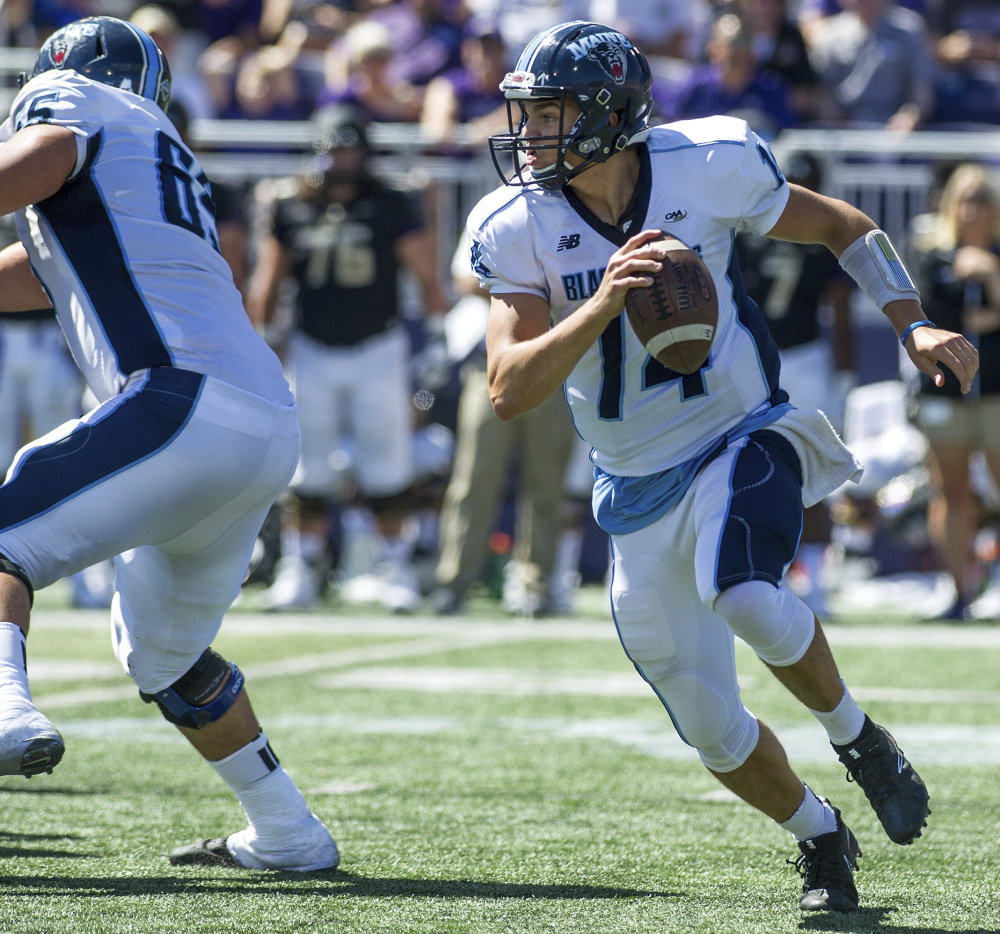 UMaine QB Chris Ferguson looks for an open receiver during a 28-10 loss to James Madison on Sept. 23. He threw three interceptions in that game and three more in a 31-0 loss to Villanova last weekend.