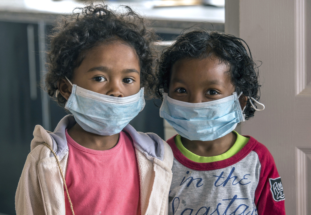 Children wear face masks at a school in Antananarivo, Madagascar. With dozens dead from a plague outbreak, the International Federation of Red Cross and Red Crescent Societies said Friday that it is deploying its first-ever plague treatment center to the island nation.