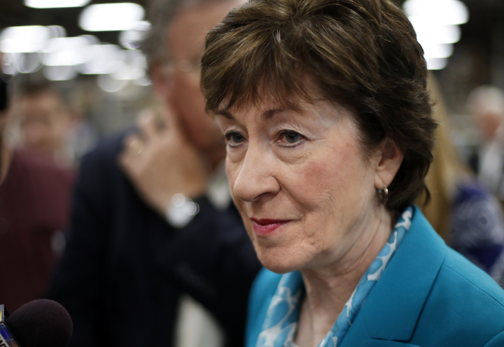 Sen. Susan Collins, R-Maine, takes a question from a reporter while attending an event in Lewiston last August.