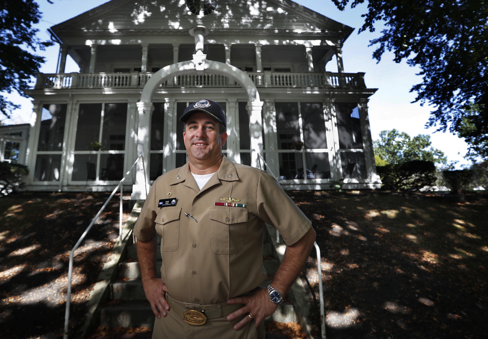 "Capt. David Hunt poses in front of Quarters ""A"", the shipyard commander's historic residence, at the Portsmouth Naval Shipyard in Kittery."