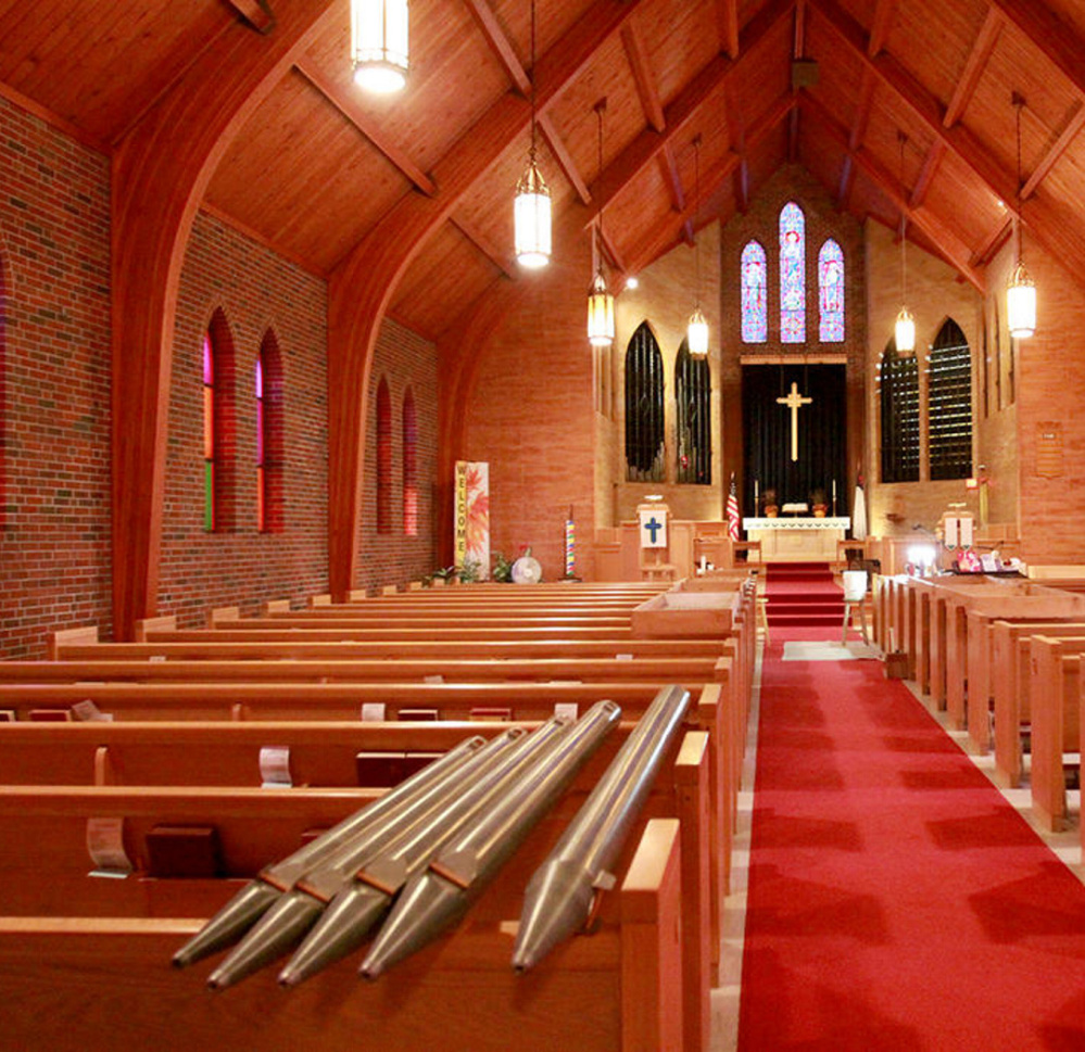 Repaired and cleaned organ pipes are stacked on pews, left, and lay in boxes at Blue Point Congregational Church in Scarborough before being reinstalled. The church raised $36,000 to refurbish the 61-year-old Austin organ and its 1,550 pipes.