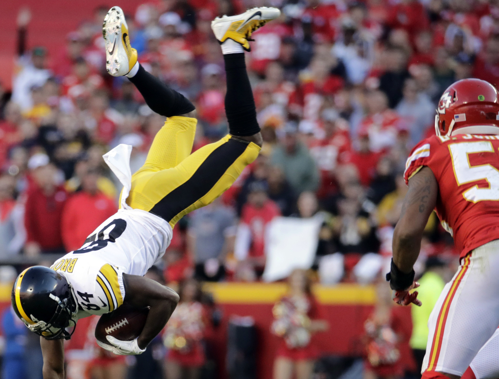 Steelers wide receiver Antonio Brown gets flipped by a tackle Sunday during Pittsburgh's 19-13 win over previously undefeated Kansas City.