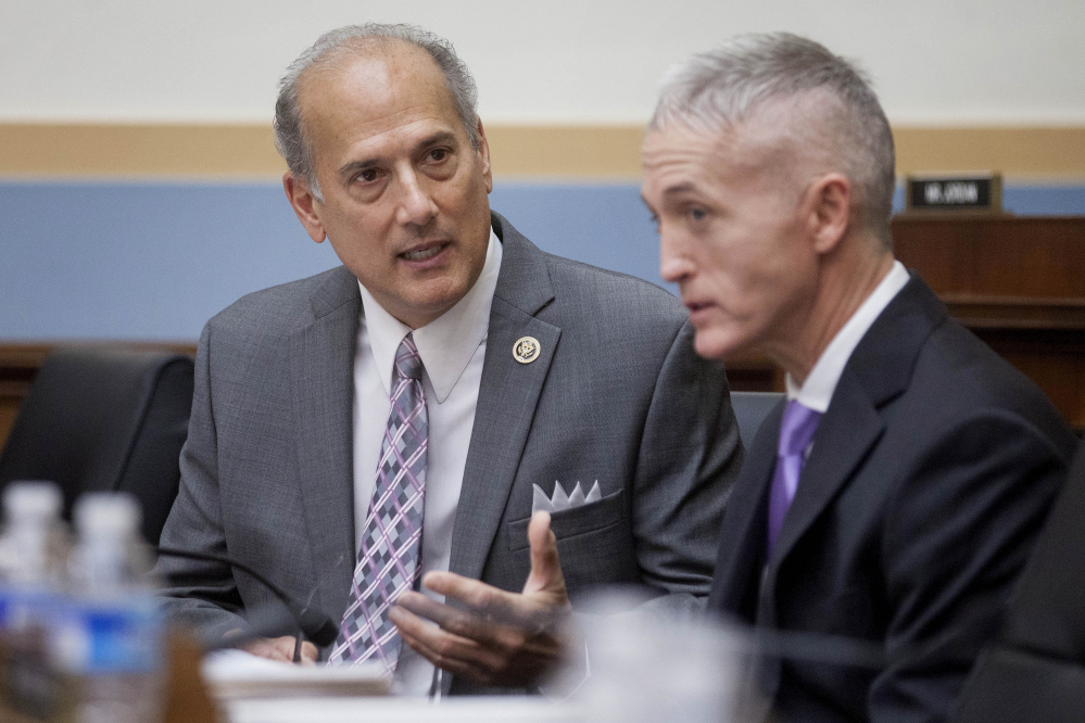Rep. Tom Marino, left, talks to Rep. Trey Gowdy, R-S.C., in November 2015. Last year, Marino won passage of a bill that has effectively undermined efforts to stanch the flow of pain pills in the U.S., according to a Washington Post/