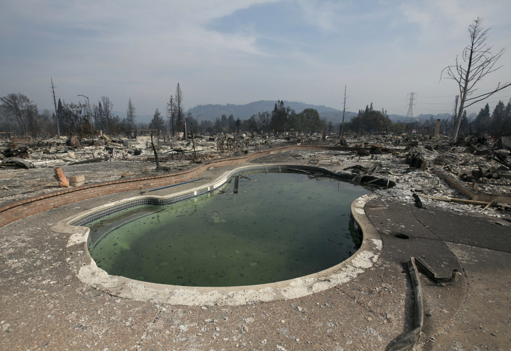 A swimming pool sits amid the charred remains of a home Monday in Santa Rosa, Calif. An estimated 2,800 homes have been destroyed by wildfires in Santa Rosa alone.