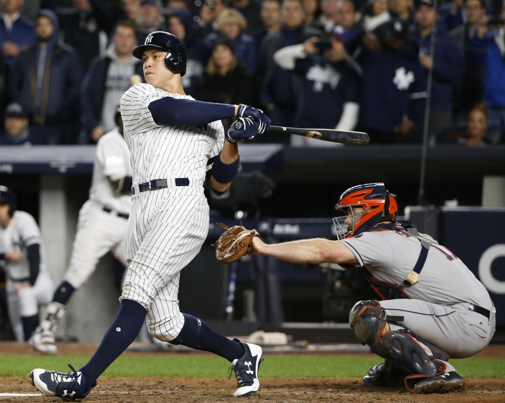Aaron Judge connects for a three-run homer in the fourth inning of Game 3 of the ALCS on Monday night in New York, helping the Yankees open an 8-0 lead over the Astros. New York won 8-1 to cut Houston's lead to 2-1 in the best-of-seven series.