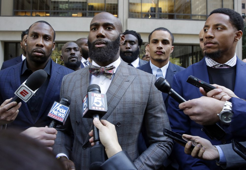 A former NFL player, Anquan Boldin, left, Malcolm Jenkins of the Eagles, center, and Eric Reid of the 49ers face the media Tueday following a discussion with owners in New York.
