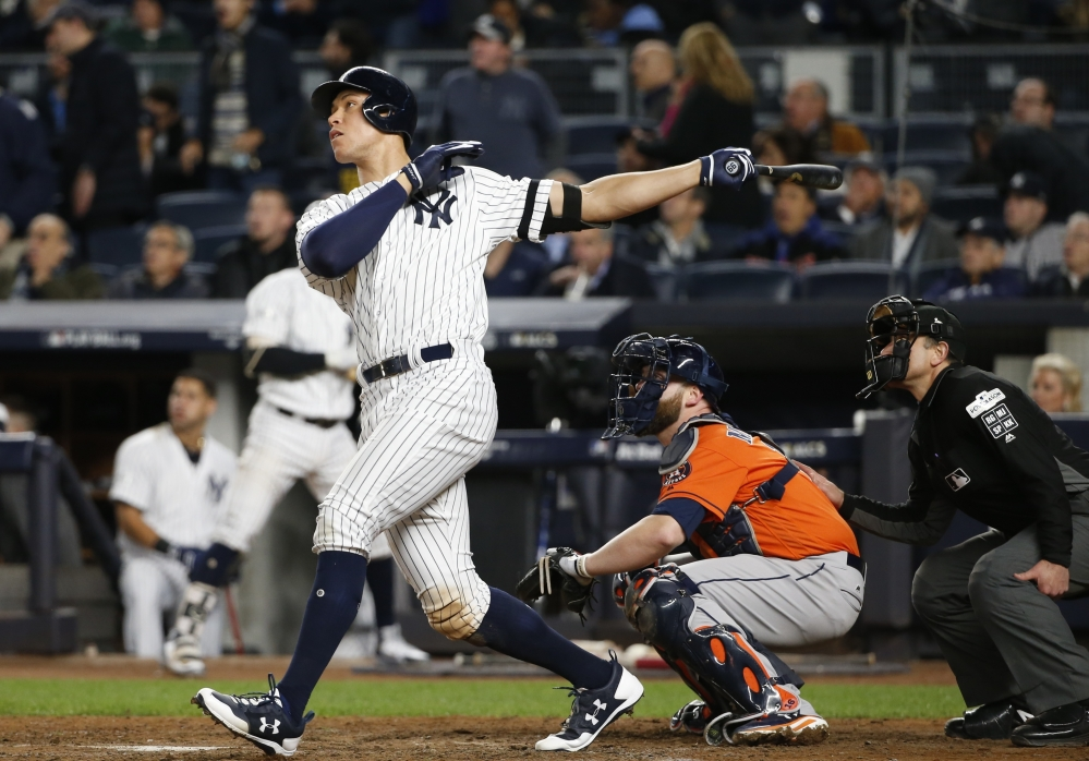 Aaron Judge hits a home run in the seventh inning in the Yankees' 6-4 win over Houston in Game 4 of the ALCS. The Yankees evened the series at 2-2 with the win.