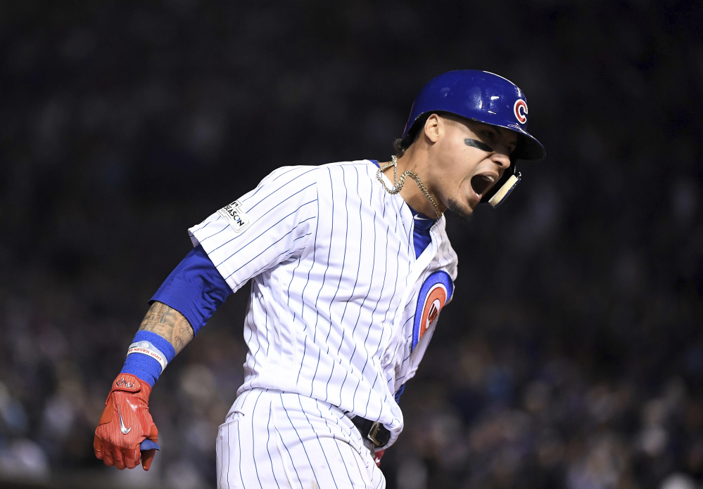Javier Baez of the Cubs runs the bases after a fifth-inning home run against the Los Angeles Dodgers Wednesday night in Chicago.