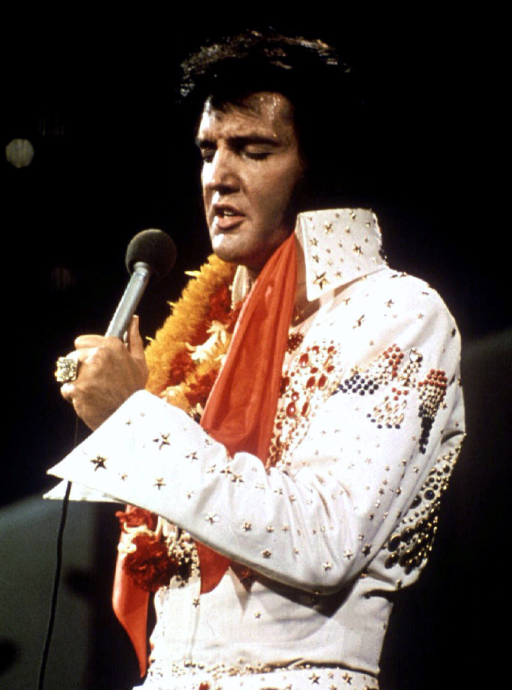 "Elvis Presley performs in concert during his ""Aloha From Hawaii"" television special in 1972."