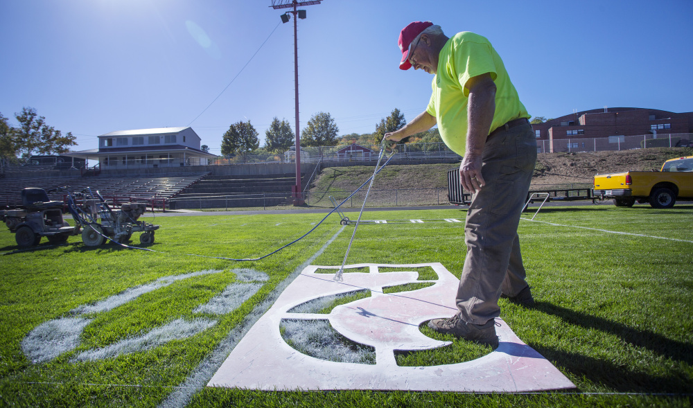Bill Thyng of the Sanford Parks and Recreation Department paints the numbers at Cobb Stadium on Thursday in preparation for Sanford's football game Friday night against Thornton Academy. Barring a Sanford upset, it will be the last high school football game at the stadium.