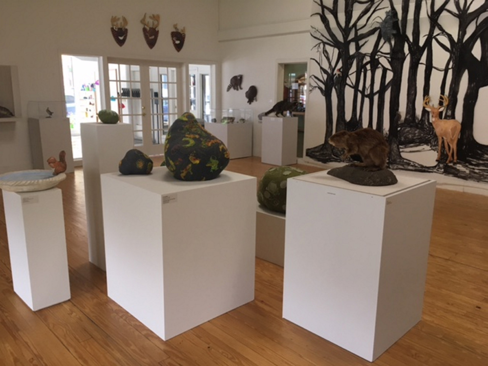 """Into the Forest"" features Barbara Sullivan's fresco animals and Juliet Karelsen's needlework rocks and minerals along with taxidermied specimens from the nearby L.C. Bates Museum."