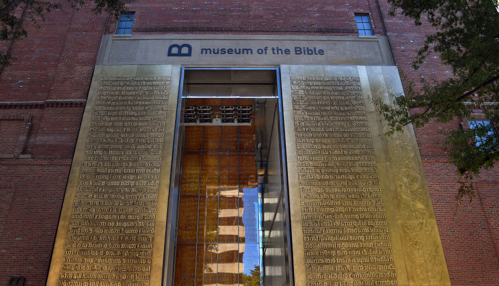 The entrance to the Museum of the Bible features relief lettering of Scriptures in Latin. At left, the children's area under construction. The museum's avoidance of controversial topics surprises some, considering its Hobby Lobby sponsorship.