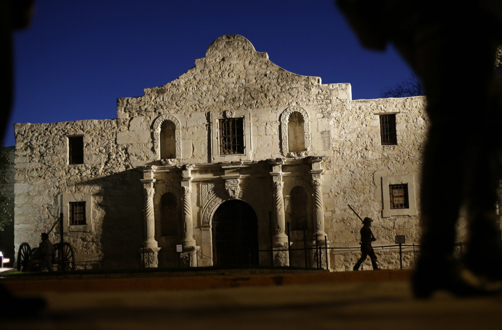 Dan Phillips, a member of the San Antonio Living History Association, patrols the Alamo in 2013. Associated Press/Eric Gay