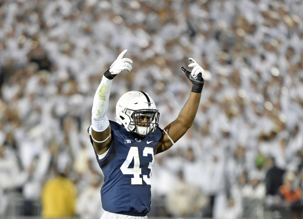 Penn State's Manny Bowen celebrates after sacking Michigan quarterback John O'Korn during the second half Saturday night in State College, Pa.