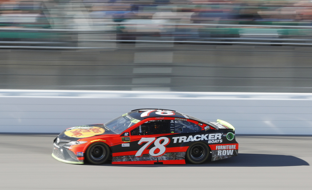 Martin Truex Jr. drives to the win in the NASCAR Cup Series race Sunday at Kansas Speedway in Kansas City, Kansas.
