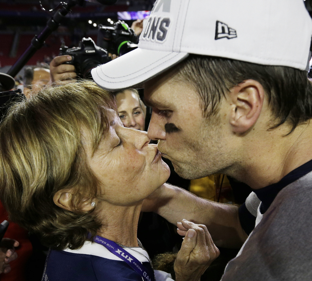 Patriots quarterback Tom Brady, right, kisses his mother Galynn after winning the Super Bowl last February.