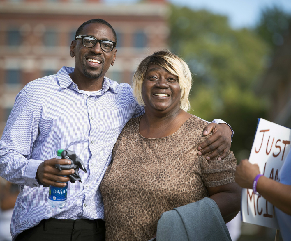 The Kansas City Star via AP Lamonte McIntyre leaves a Kansas City courthouse on Oct. 13 with his mother, Rosie McIntyre, after the district attorney dropped charges for which he'd served 23 years.