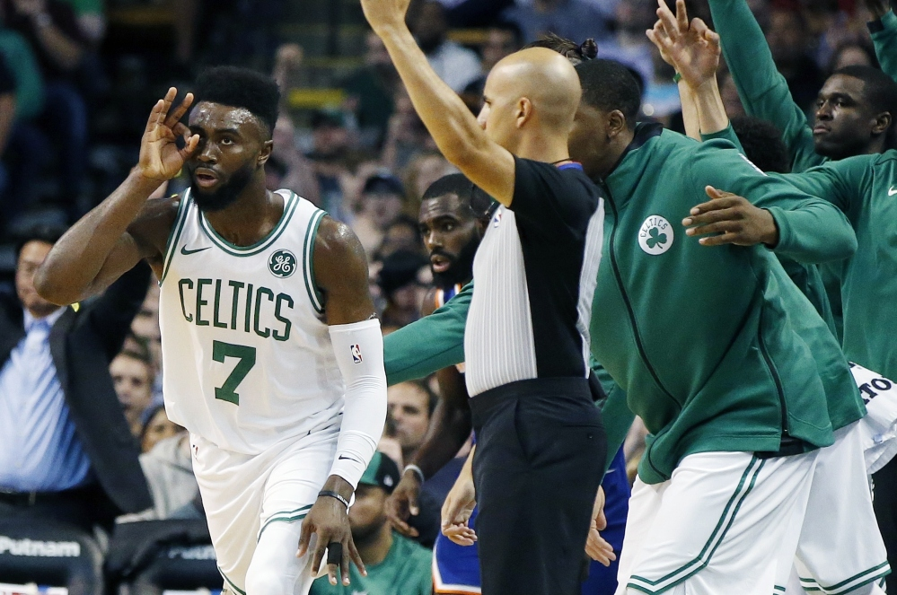 Boston's Jaylen Brown, left, celebrates a first-quarter 3-pointer during the Celtics 110-89 win at home against the New York Knicks on Tuesday night. Brown had a team-high 23 points.