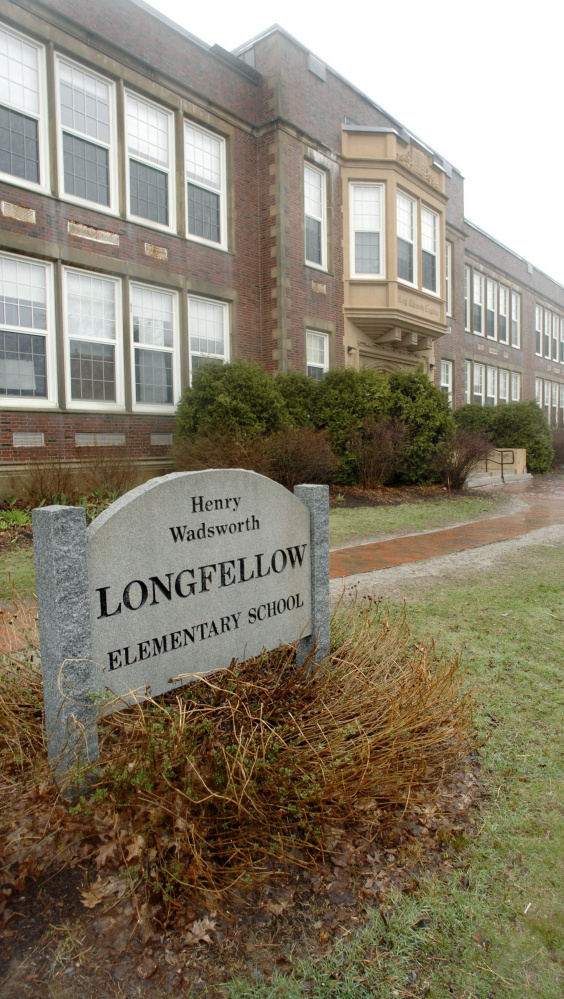 On Oct. 3, parents noticed a discoloration on a hallway ceiling at Longfellow Elementary School in Portland. Testing revealed that it wasn't mold.