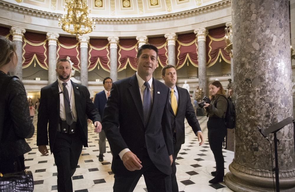 Speaker of the House Paul Ryan, R-Wis., strides to the chamber for the vote on the $4 trillion budget measure that will pave the way for a sweeping Republican tax overhaul, on Capitol Hill in Washington on  Thursday.