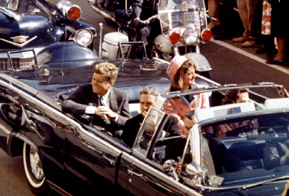 President John F. Kennedy, first lady Jacqueline Kennedy and Texas Gov. John Connally ride in a limousine moments before Kennedy was assassinated in Dallas, Texas.