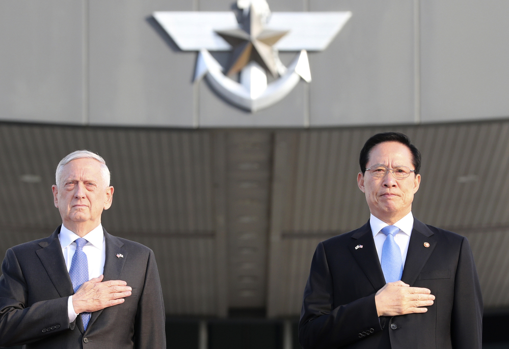 Defense Secretary Jim Mattis and South Korean Defense Minister Song Young-moo appear at a welcome ceremony at the Defense Ministry in Seoul, South Korea, on Saturday.