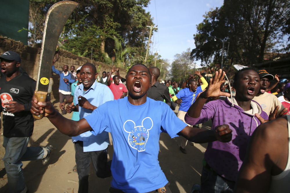Opposition supporters take to the street in Nairobi's Kawangware area on Saturday, a day after voting was postponed in areas of Kenya where police and protesters have clashed.