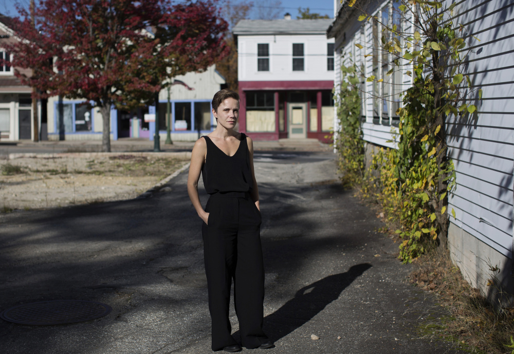 Sarah Perry, 35, on Main Street in Bridgton. Perry pored through scores of police reports and interviewed dozens of family members and friends over six years to better understand a horrific night in 1994 when she heard her mother's murder beyond a closed door.