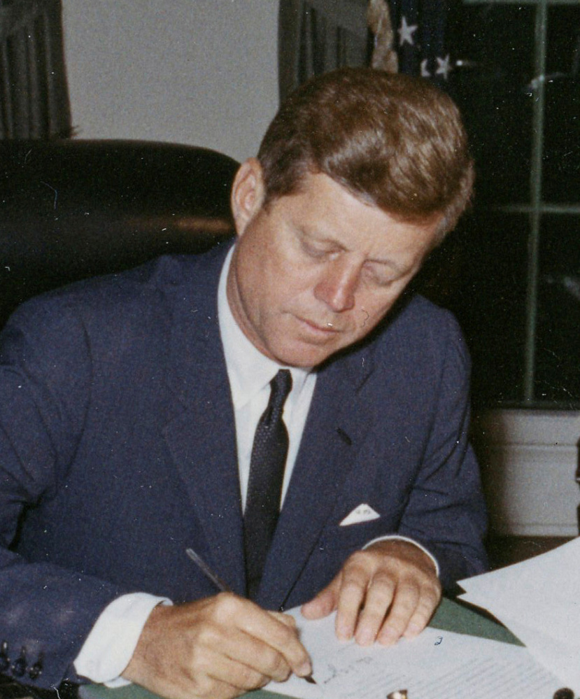 President Kennedy signs a proclamation during the Cuban missile crisis.